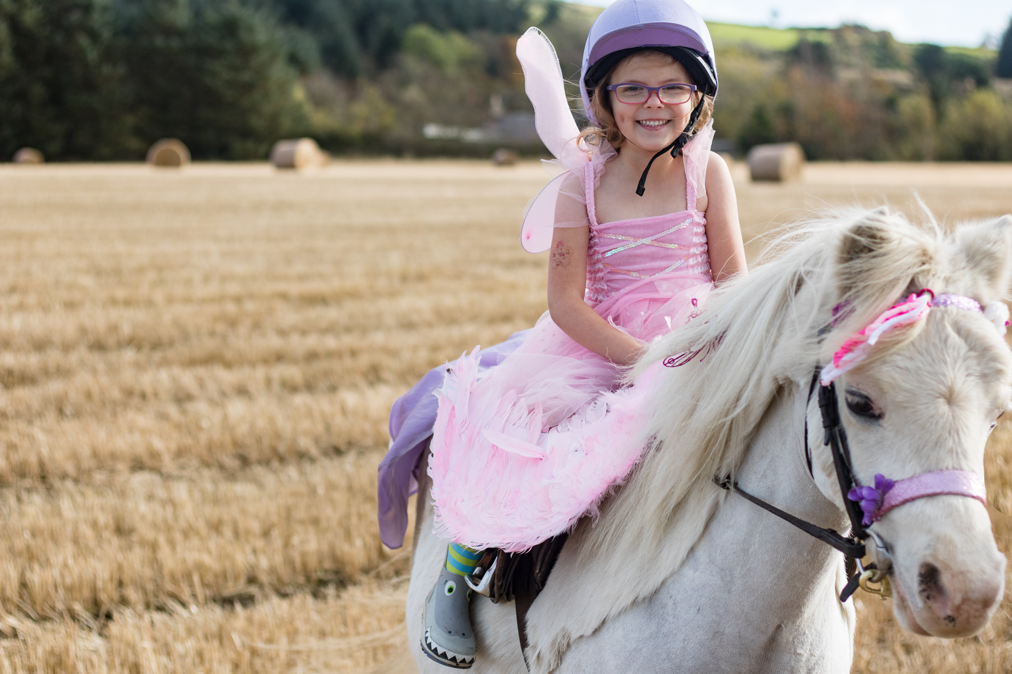 Girl dressed as fairy on horse