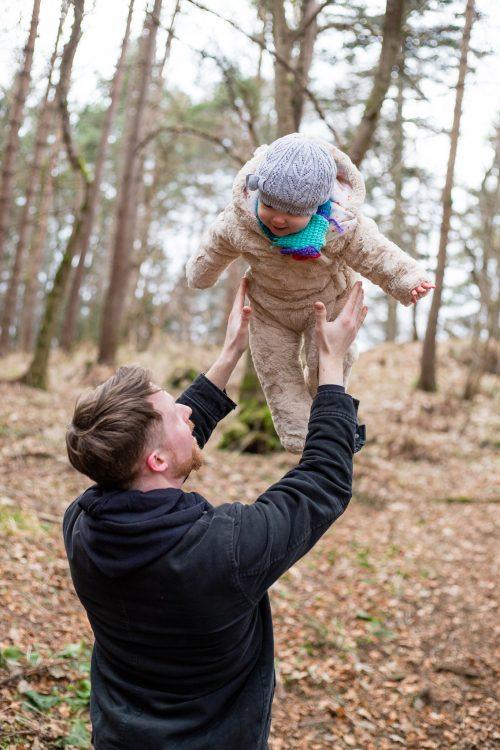 Aberdeenshire Family Photographer Family Session at Leith Hall dad throwing baby up in the air