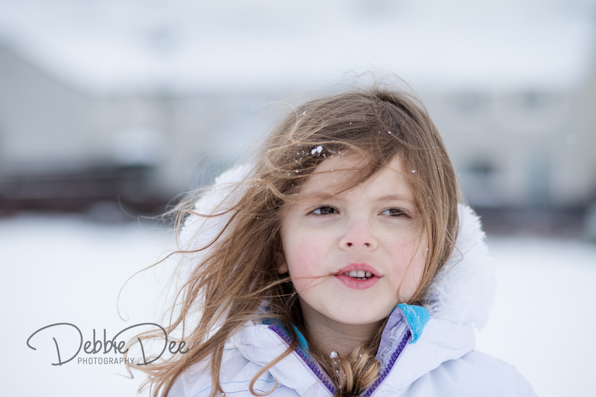 Girl with hair blowing in the snow