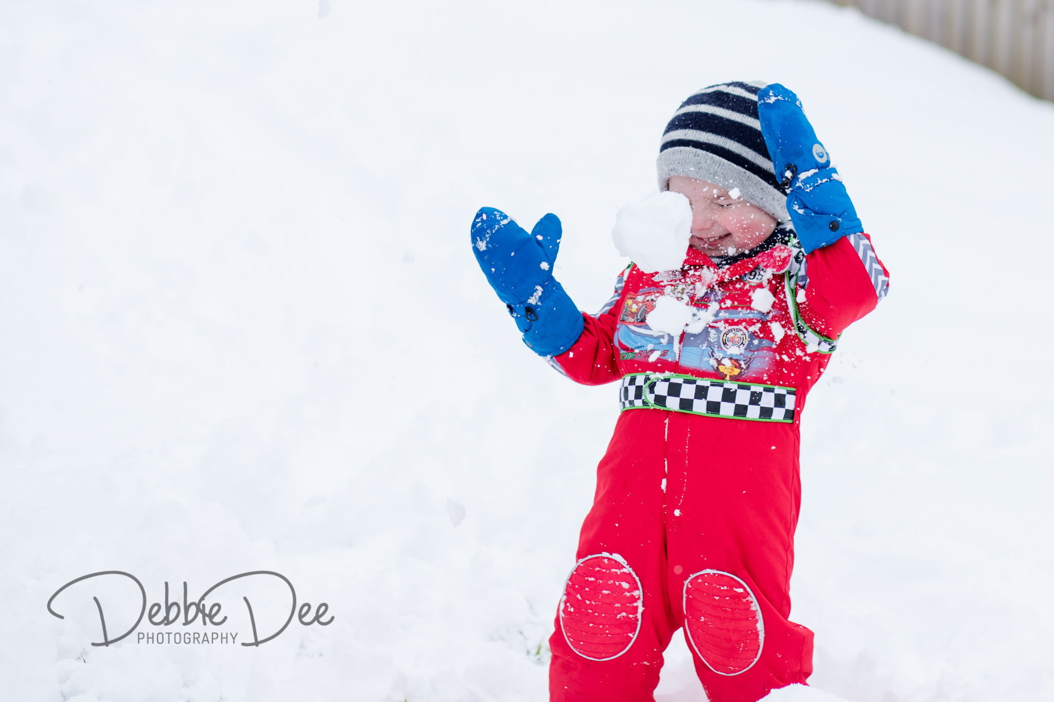 Snowball hitting smiling little boy