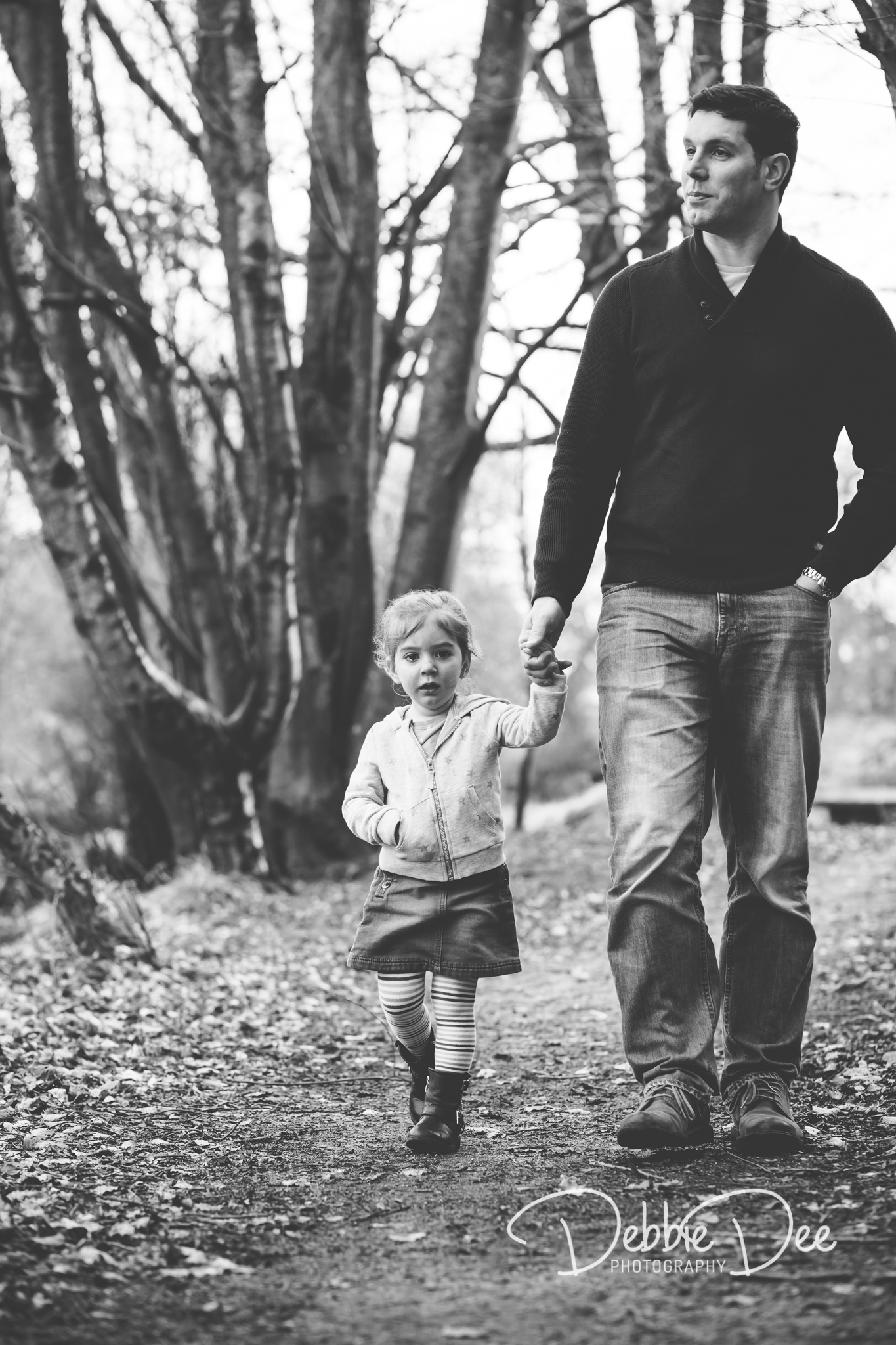 Aberdeenshire Family Maternity Photography Session dad and daughter holding hands walking
