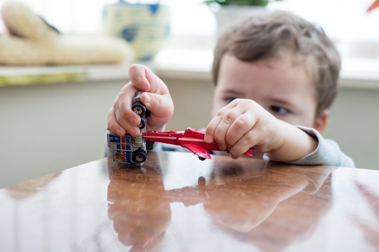 Aberdeenshire Family Photographer Debbie Dee Photography In-Home Lifestyle Photography - child playing with toy plane