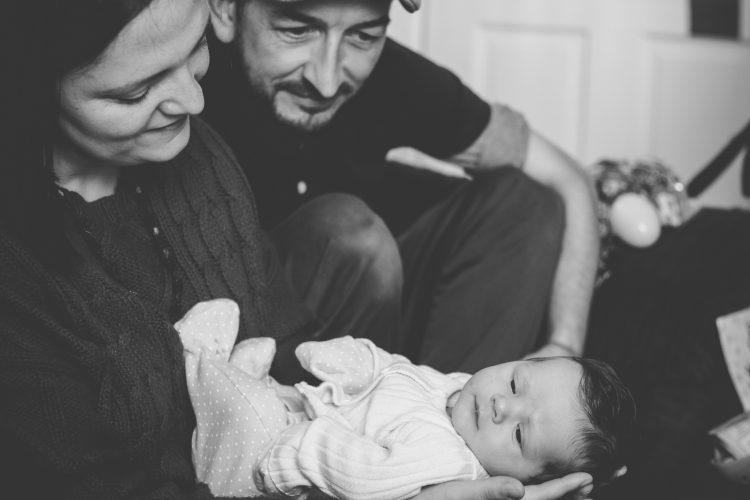 Aberdeenshire Newborn Photographer Debbie Dee Photography In-home newborn photography - mum and dad smiling down at baby