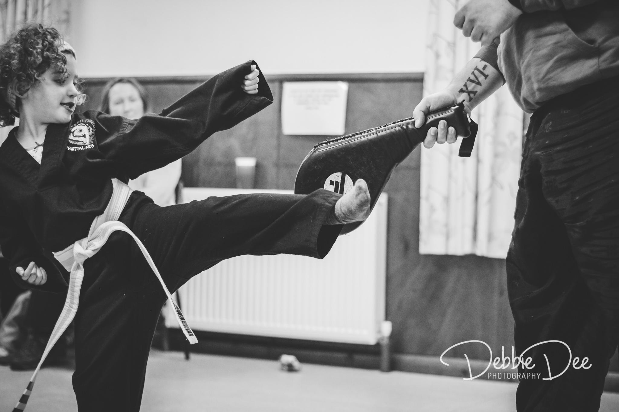 Eastern tigers martial arts girl kicking
