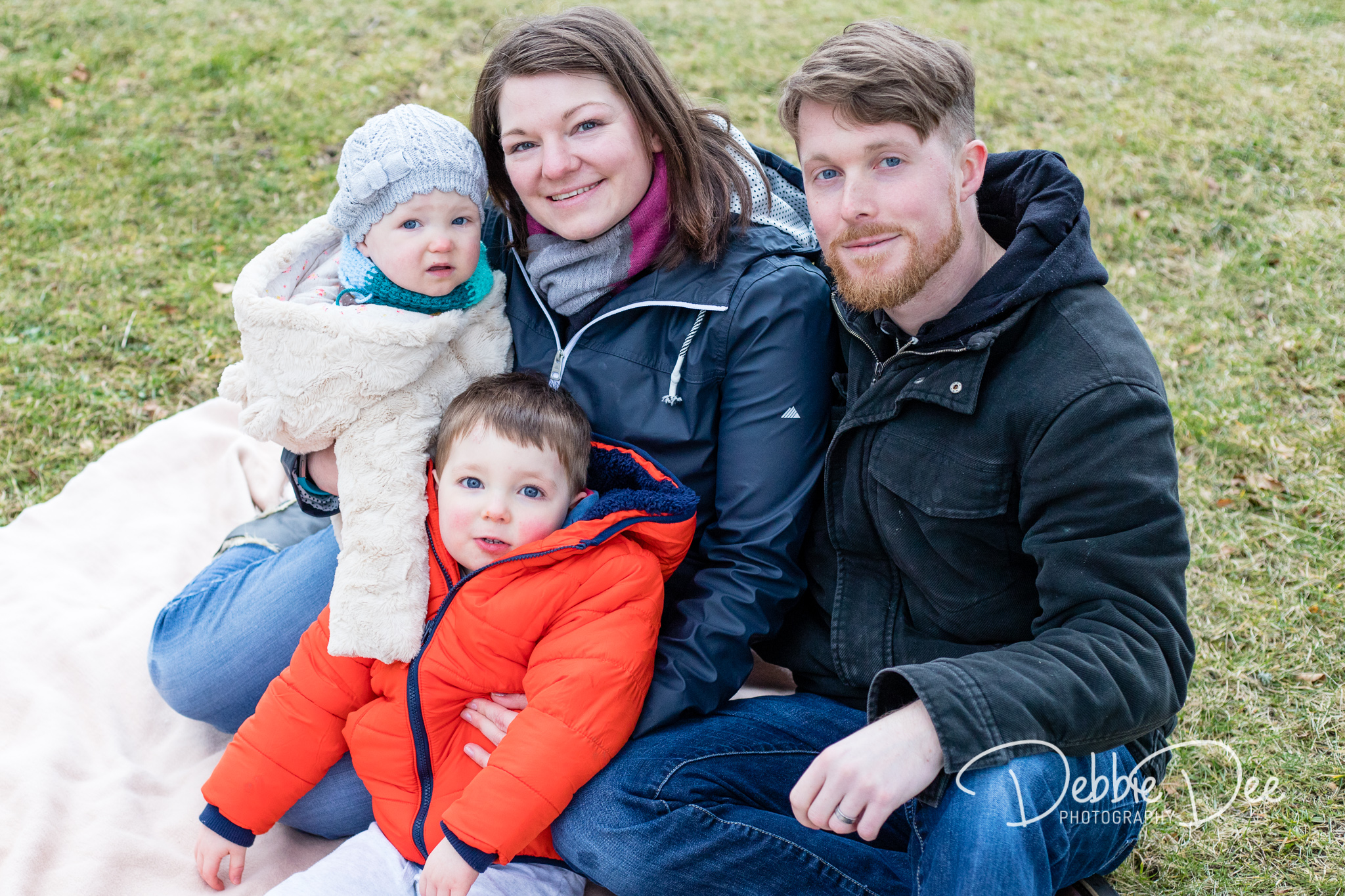 Family Photography Aberdeenshire - Leith Hall Aberdeenshire - Debbie Dee Photography - Outdoor Family Photography Session - family of four sitting together