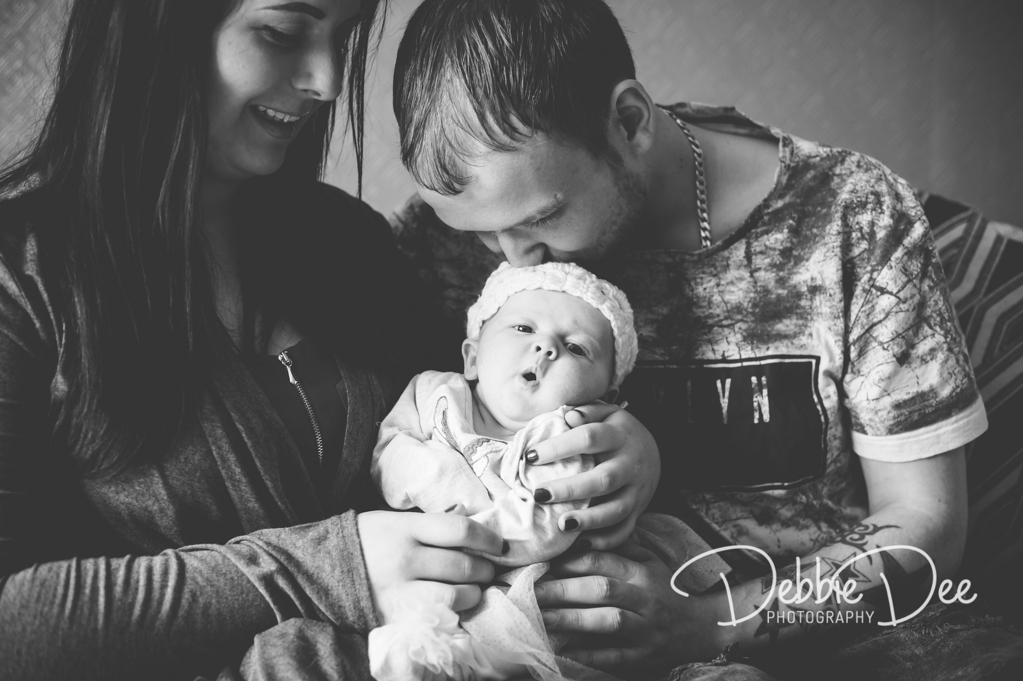 Family photography in-home lifestyle session aberdeenshire Debbie Dee Photography Dad kissing baby