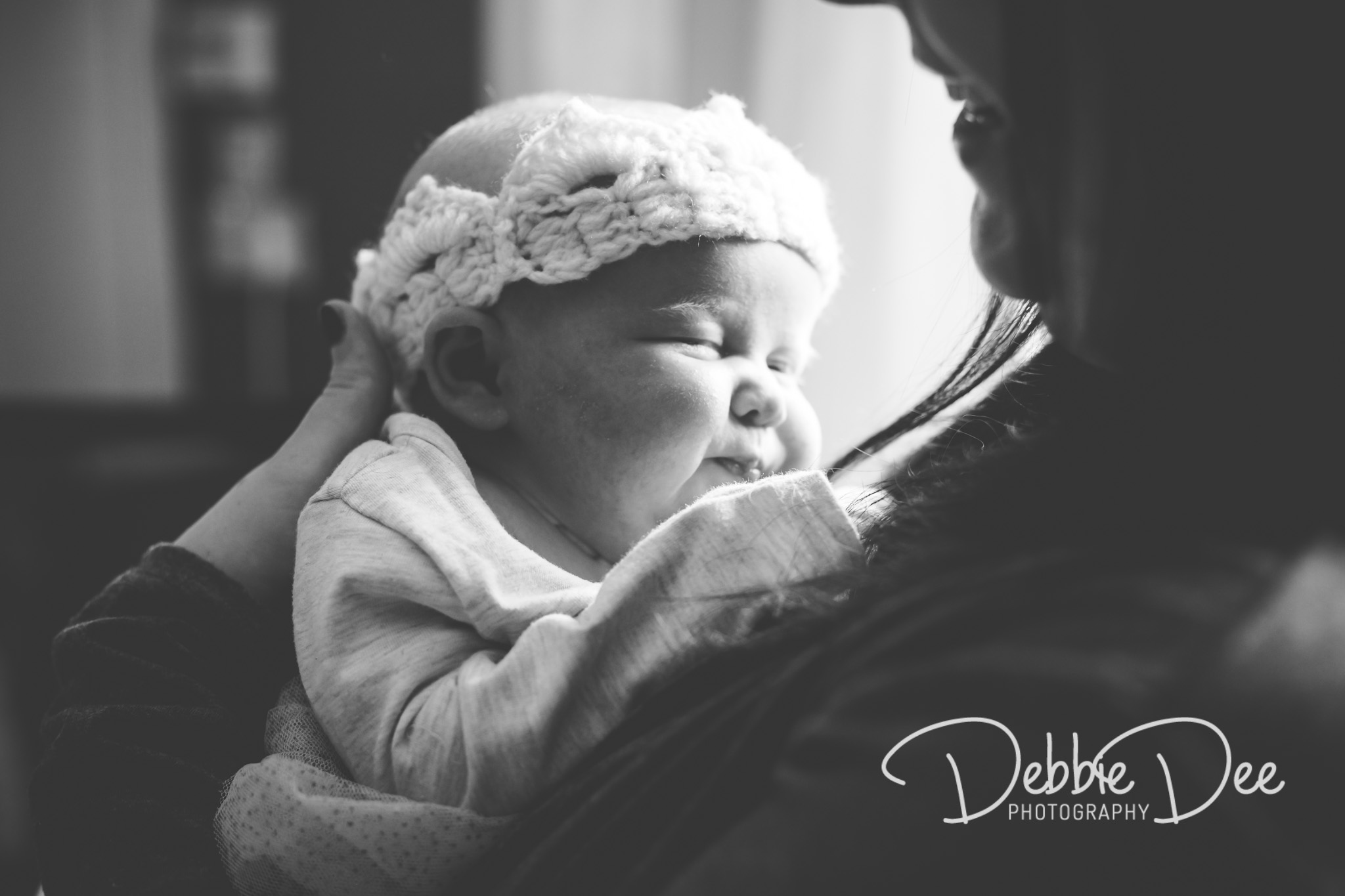Family photography in-home lifestyle session aberdeenshire Debbie Dee Photography baby held in mums arms