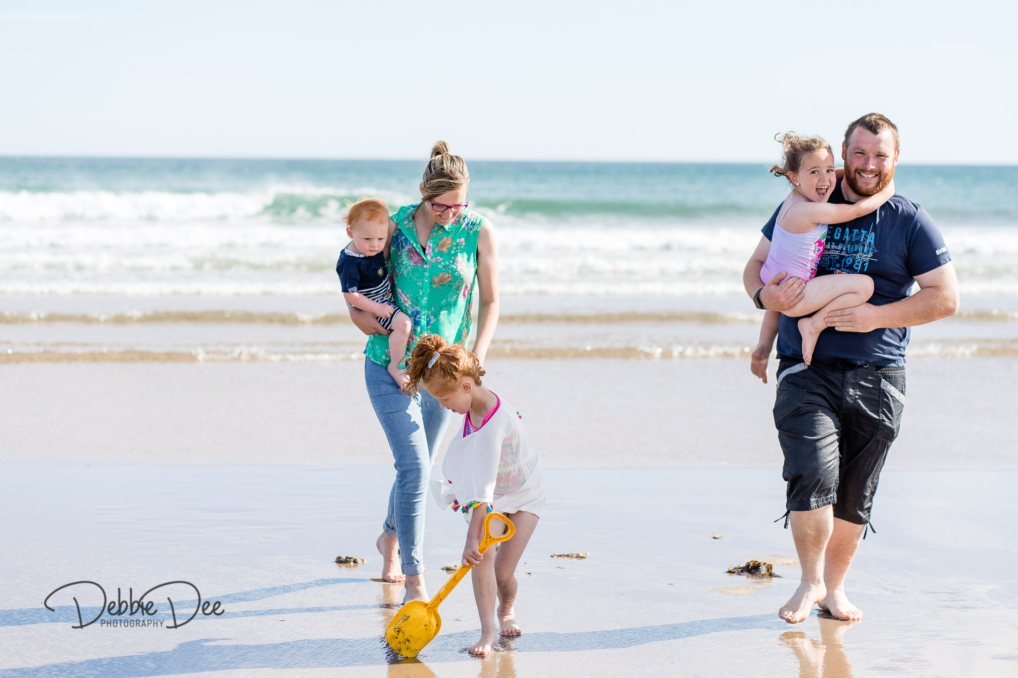 Family photography session banff beach aberdeenshire Debbie Dee Photography family walking along beach