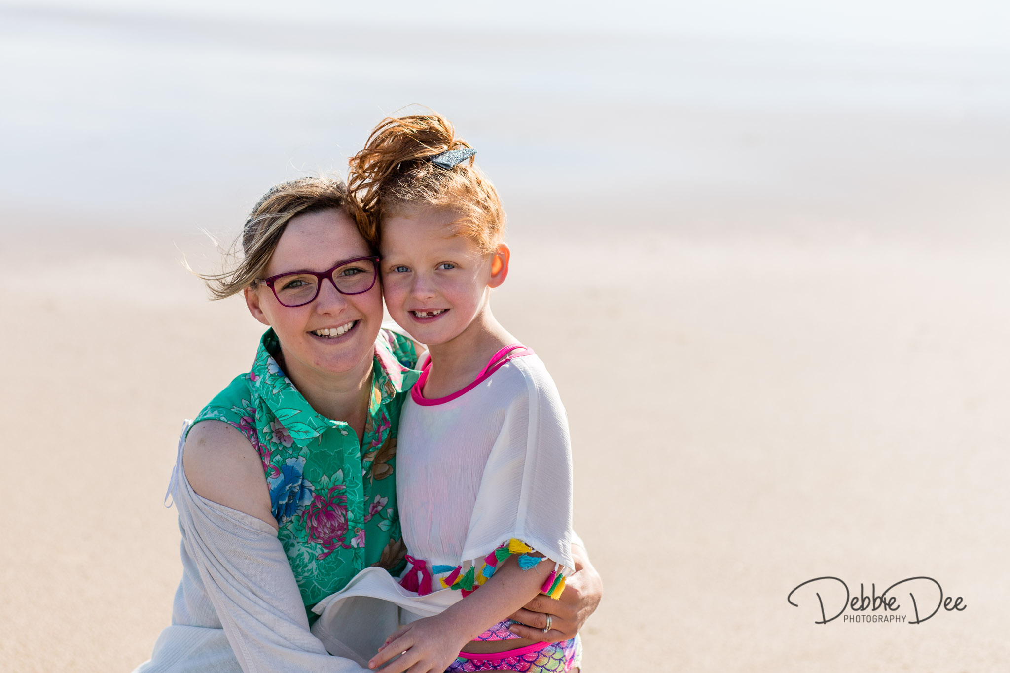 Family photography session banff beach aberdeenshire Debbie Dee Photography daughter and mum hugging