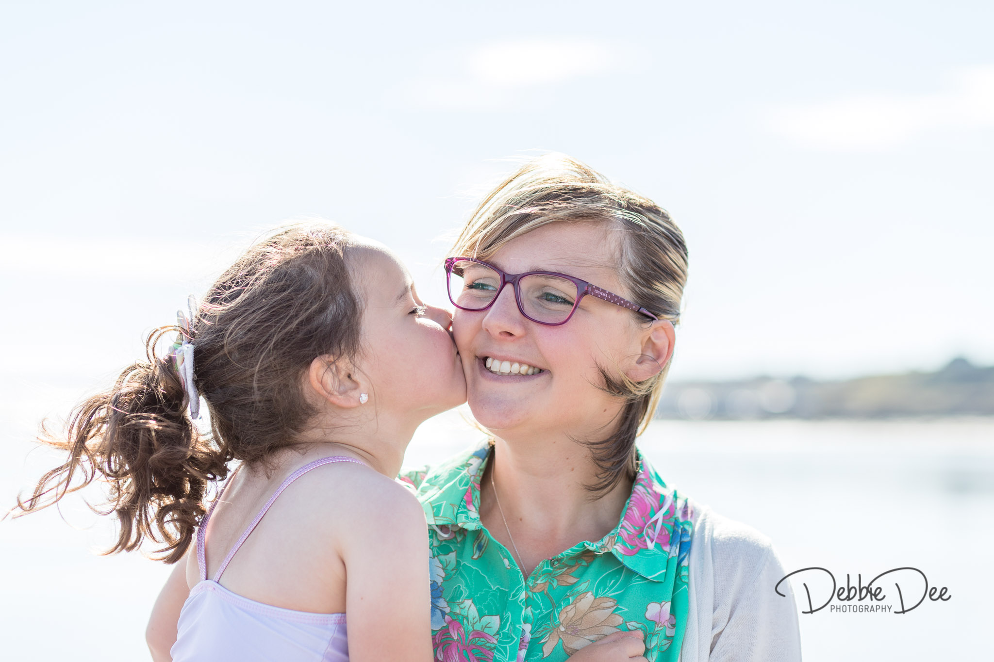 Family photography session banff beach aberdeenshire Debbie Dee Photography girl kissing mum