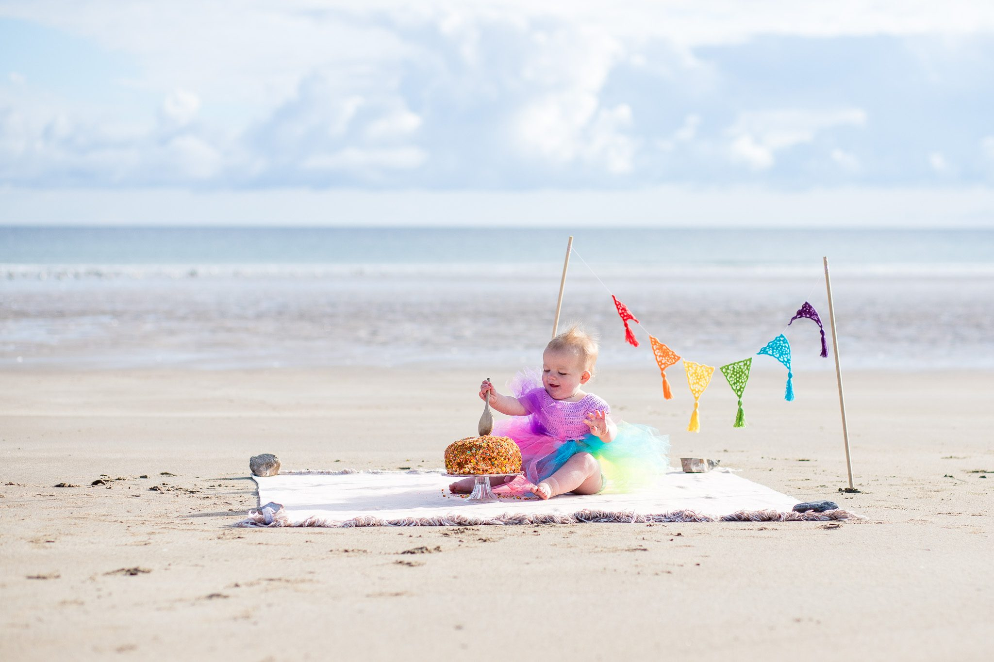 Cake smash Photographer Aberdeenshire - Family photography aberdeenshire - Debbie Dee Photography - Lifestyle Family - Rainbow cake smash on sandend beach
