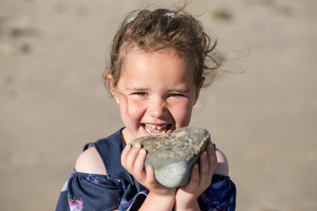 Family Photographer Aberdeenshire - Family photography aberdeenshire - Debbie Dee Photography - Lifestyle Family - child holding rock on banff links beach