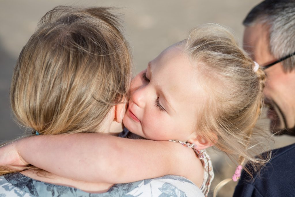 Family Photographer Aberdeenshire - Family photography aberdeenshire - Debbie Dee Photography - Lifestyle Family - Mum and daughter hugging - banff beach