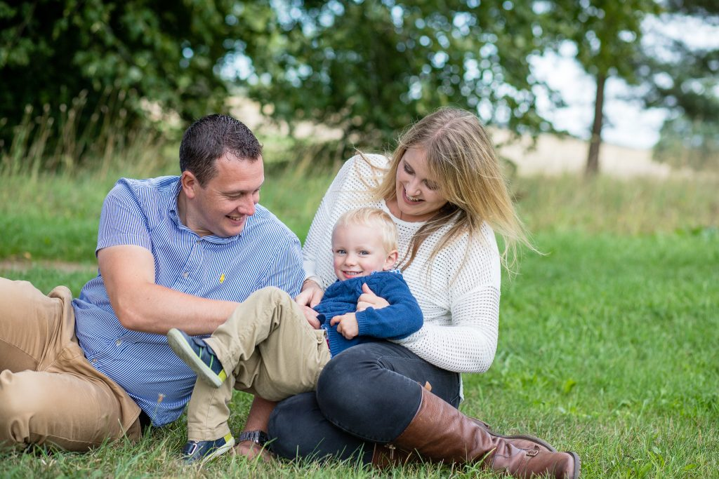 Family Photographer Aberdeenshire - Family photography aberdeenshire - Debbie Dee Photography - Lifestyle Family - Family sitting together on grass