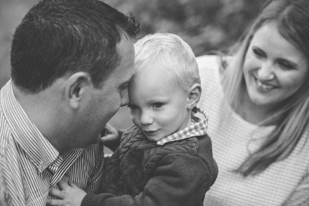Family Photographer Aberdeenshire - Family photography aberdeenshire - Debbie Dee Photography - Lifestyle family photos - dad cuddling son and mum watching on