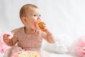 Girl eating cake - cake smash photography session - Debbie Dee Photography - Aberdeen Aberdeenshire