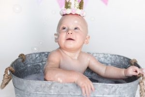 Cake smash and splash bath aberdeen aberdeenshire moray - baby in tin bath staring up at bubbles - Debbie Dee Photography