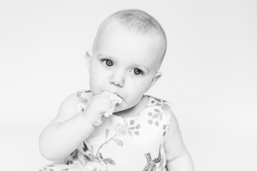 Black and white child's face eating cake at smash and splash session - aberdeenshire photographer Debbie Dee Photography