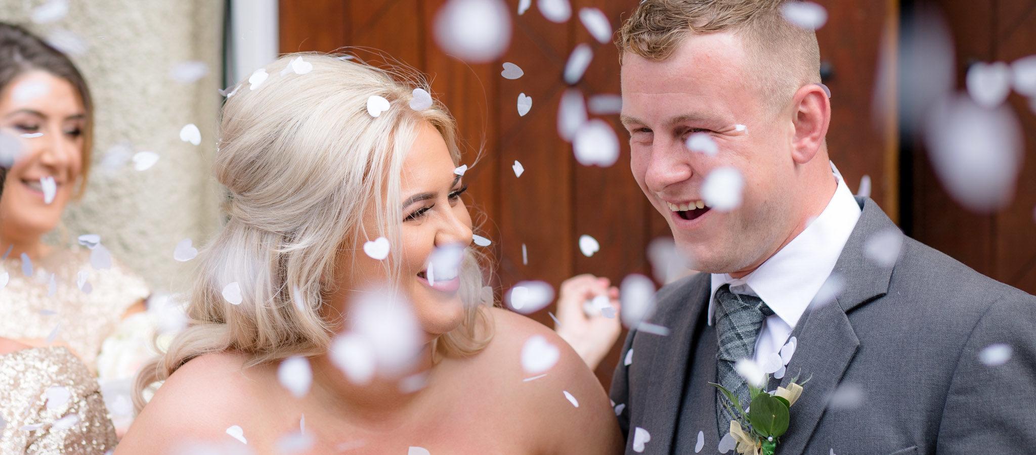Confetti over bride and groom - Wedding photographer aberdeenshire, aberdeen, huntly, scotland - Debbie Dee Photography