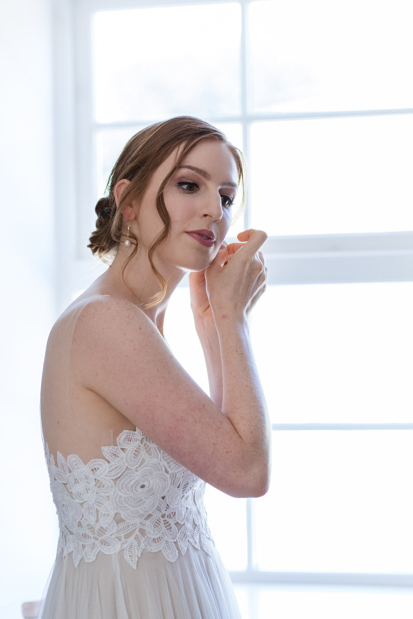 Bride by window putting in earring - Wedding photographer aberdeenshire, aberdeen, huntly, scotland - Debbie Dee Photography