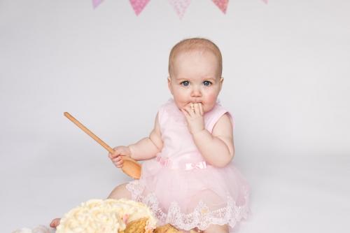 Child eating cake - cake smash and splash aberdeen - debbie dee photography