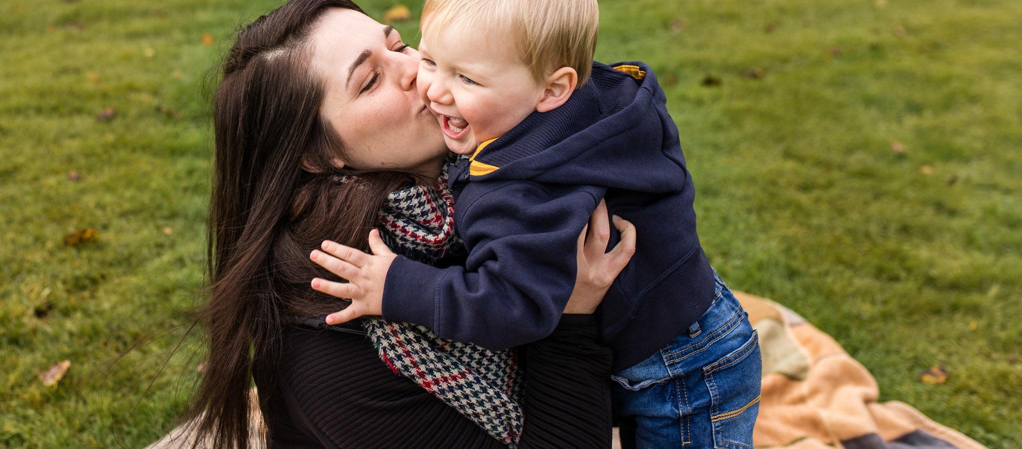 Mum kissing child - family photographer aberdeen aberdeenshire - leith hall - debbie dee photography