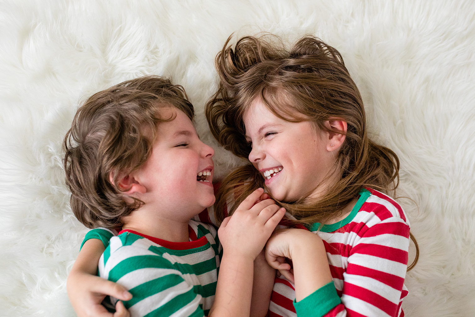 Siblings laughing and smiling at each other - Debbie Dee Photography - Aberdeen Photographer