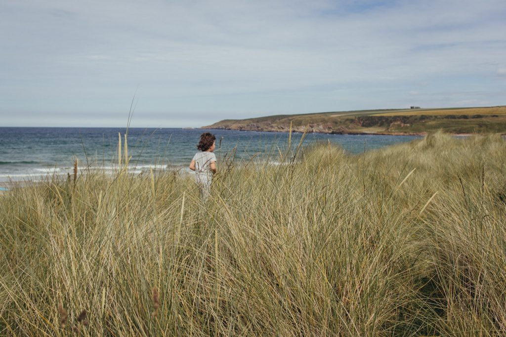 Running in sand dunes at Sandend Beach - Debbie Dee Photography - Aberdeenshire family photography